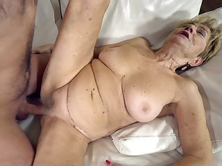 Big granny titties bounce as the young guy fucks her