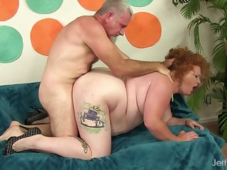 Ginger plumper Scarlett Raven gets a hard drilling in doggystyle position