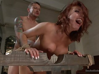 Redhead officer Britney Amber in the matter of a nice smile fucked by a prisoner
