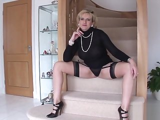Unfaithful British milf lady Sonia displays her massive breasts
